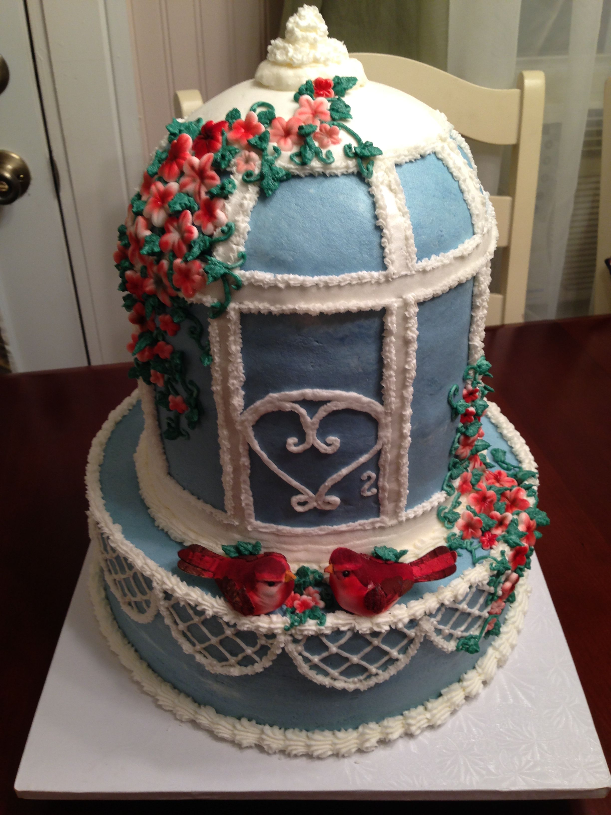 The birdcage cake! All in buttercream except flowers which are fondant and birds! Bird cage