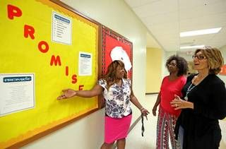 """Broward County ended out-of-school suspensions several years ago — an approach that Miami-Dade will adopt this year as well. At Pine Ridge Education Center in Fort Lauderdale, Principal Belinda Hope talks with teachers Geraldine Bartelle and Laura Kolo about Broward's """"PROMISE"""" program, which aims to keep students out of trouble while being disciplined for bad behavior. It stands for Preventing Recidivism through Opportunities, Mentoring, Interventions, Support & Education."""