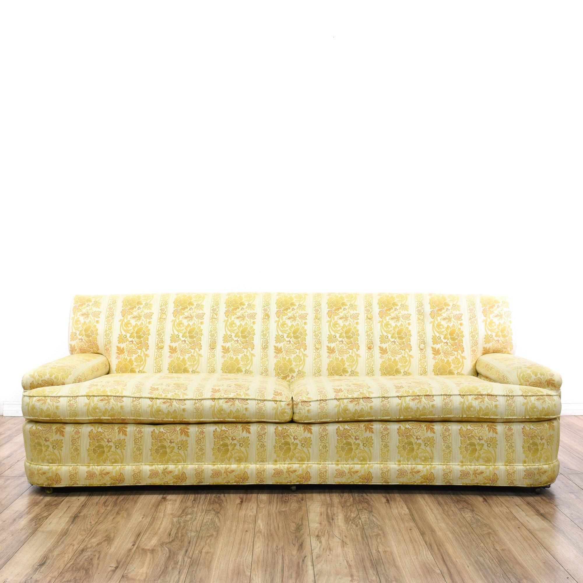 This mid century modern sofa is upholstered in a durable yellow and white fabric with floral striped print. This long sofa has a low back, cushion arms and a curved in front. Comfortable couch perfect for long cat naps! #midcenturymodern #sofas #sofaorcouch #sandiegovintage #vintagefurniture