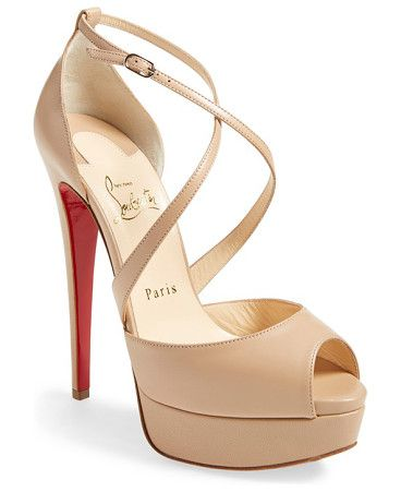 cross me platform sandal by Christian Louboutin. Slender kidskin straps wrap seductively across the foot, adding polished allure to a chic peep-to...