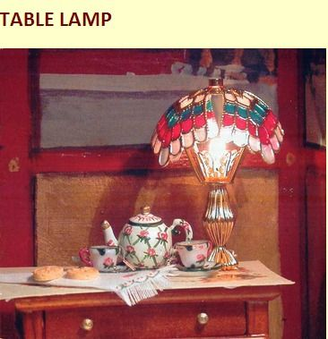 Instructions for making this table lamp and many other items for a dollhouse out of  brass ornaments and Swarovski Beads.