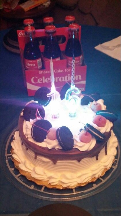 Ice Cream Cake From Publix With Flashing Candle Sticks And Glass Coke Bottles