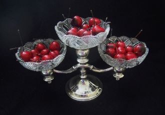 Triple Plate - Home Run..... Sterling silver plated candlelabra embellished with (3) clear cut glass bowls.  Beautiful in it's simplicity.