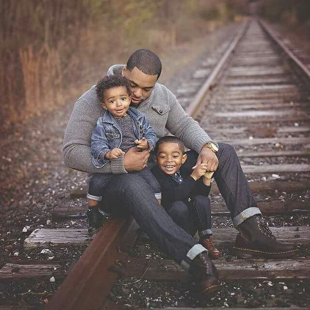 Image result for black fathers with their babies
