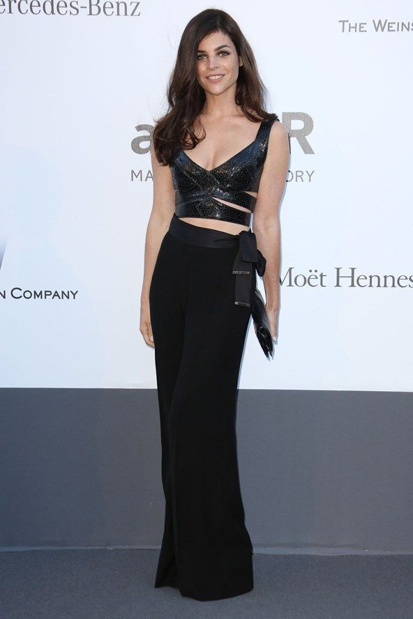 Cannes amfAR Gala May 23, 2013: Julia Restoin-Roitfeld in black wide-leg trousers and a leather bustier top.