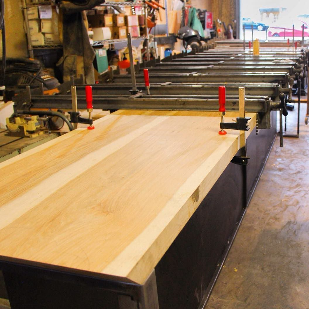 feet of pecan clamped up for a foot waterfall dining table