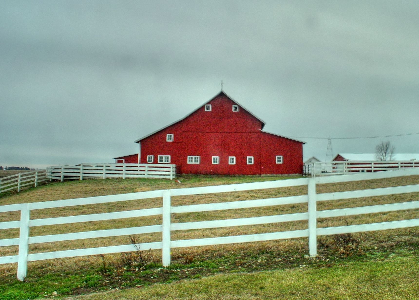 Little red barn with white fence.