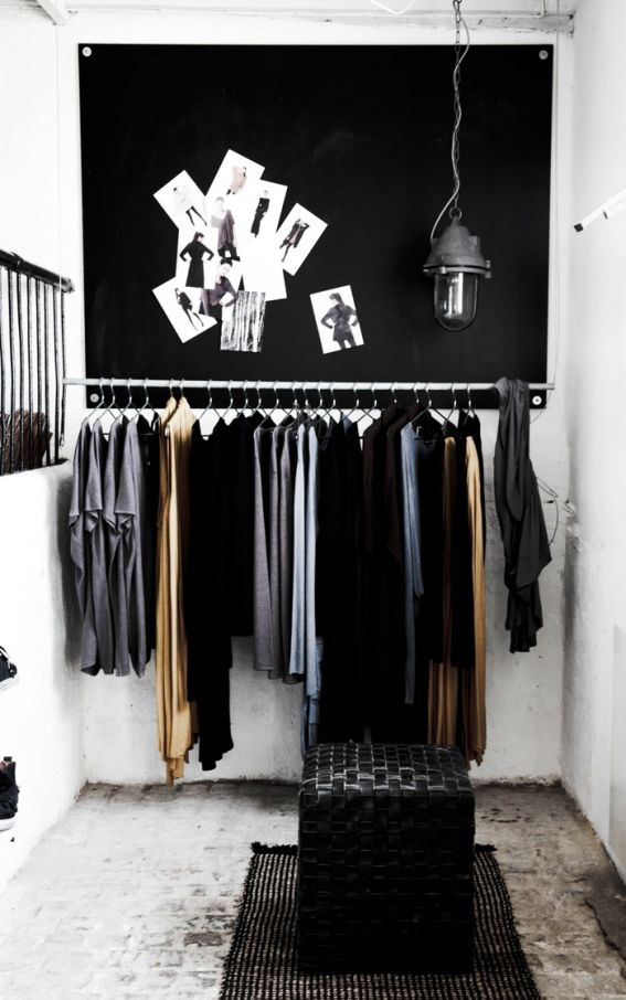 love the idea of a pinboard above clothing racks