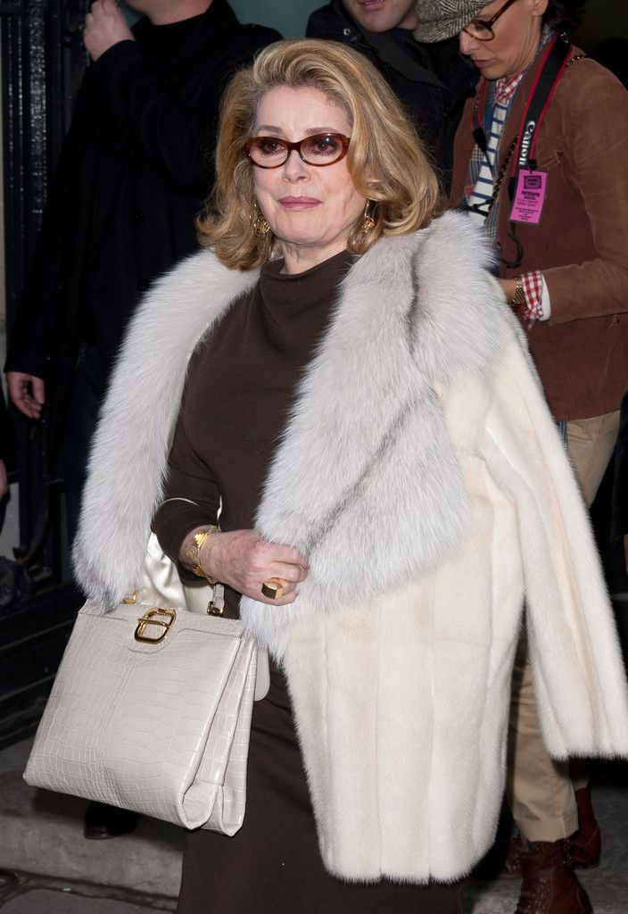 Catherine Deneuve attending the Jean-Paul Gaultier Spring/Summer 2012 Haute Couture collection show in Paris.