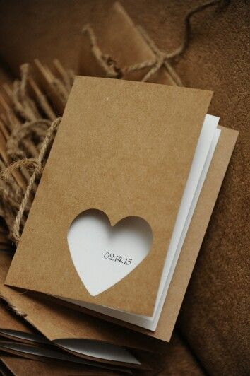 DIY programs! So easy and much cheaper than custom made. Kraft paper, cardstock, a few hole punches and twine.