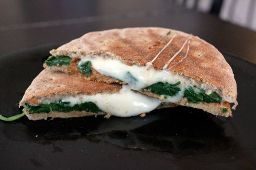 Sandwich... 100 calorie thin, light babybel, tomato sauce, and loads of fresh spinach.