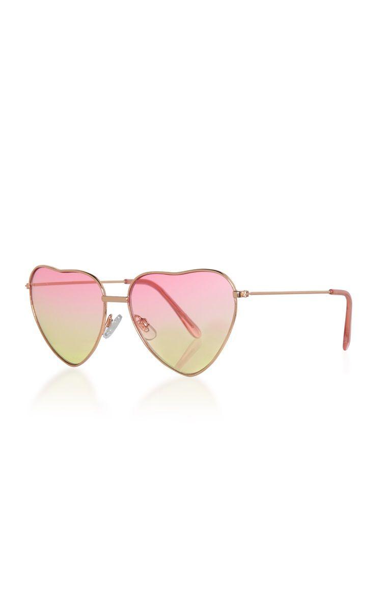 f75652267614 Roze zonnebril met hartvormige glazen