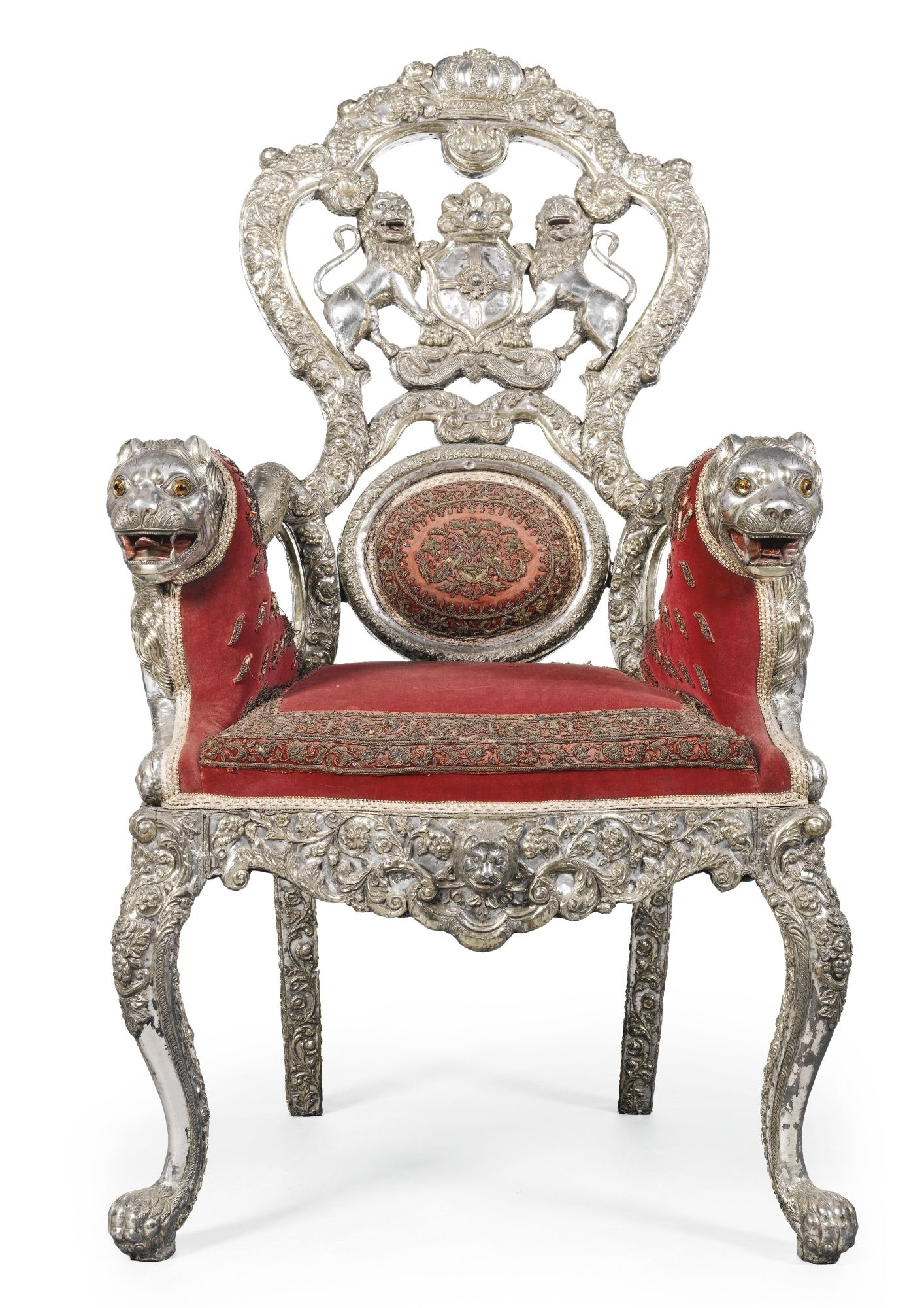 An Indian repoussé silver veneered throne armchair possibly Baudh