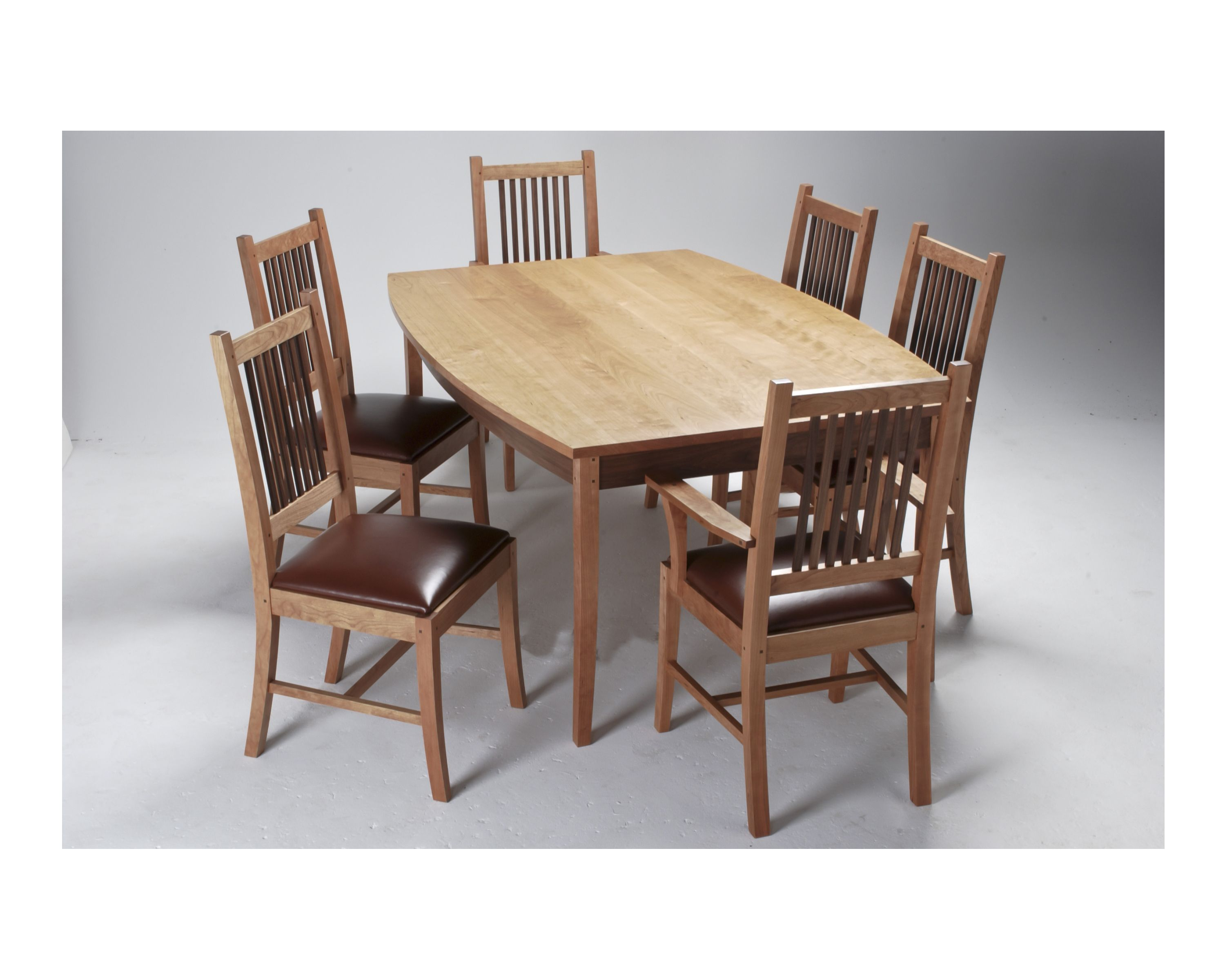 Boat top table with Mission dining chairs Cherry with Walnut