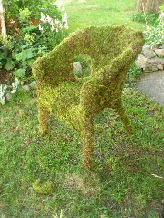 Moss covered chair, would be great as a storytellers chair in a little clearing in the wood