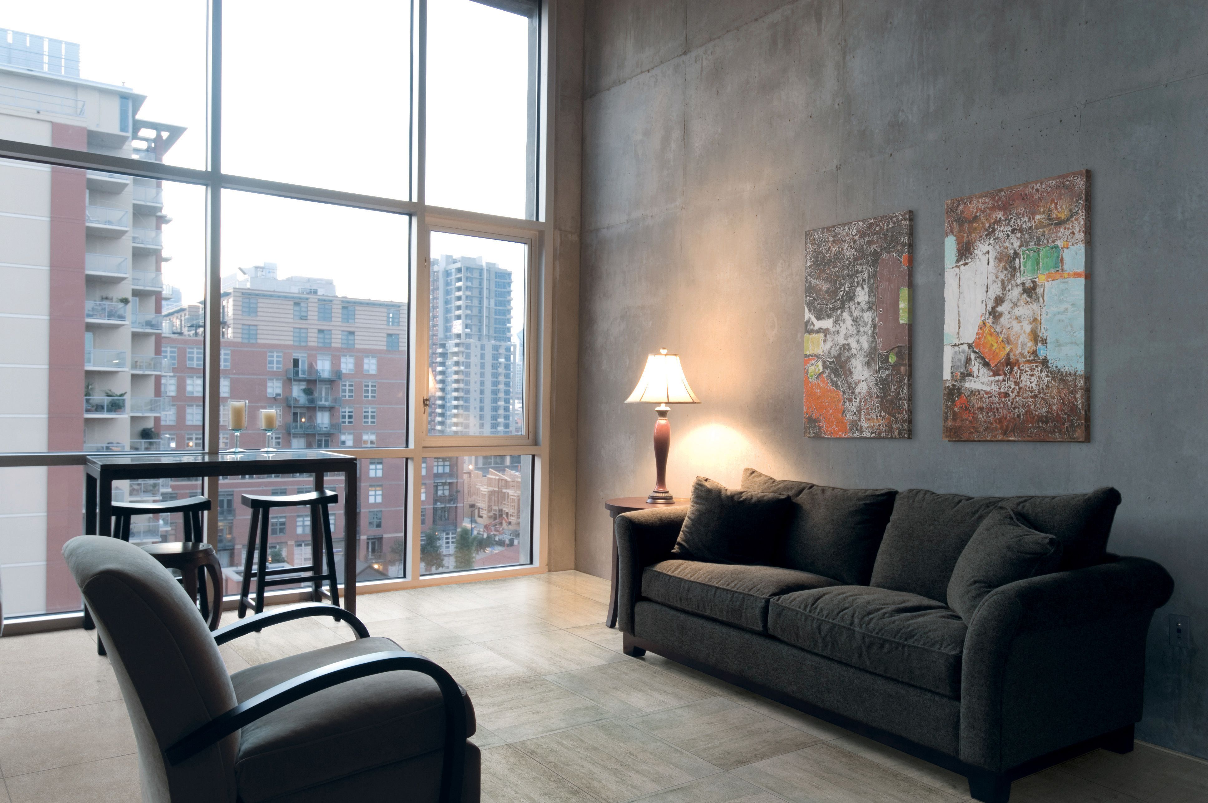 A condo living room overlooking the city has a modern look with our