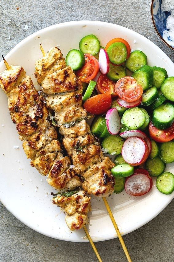 Easy lemon chicken skewers with garlic and herbs are delicious healthy and fast making them perfect for summer dinners served with simple side dishes