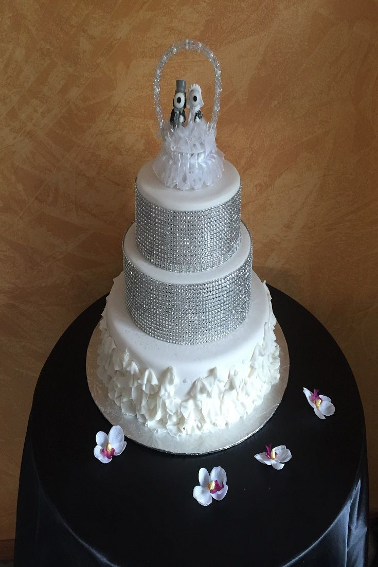 This wedding cake topper has Snoopy and Belle. The groom is looking ...