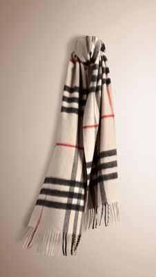9f24c993d9d1 Burberry Classic Cashmere Scarf in heritage check is made at a 200-year-old  mill in the Scottish countryside using 30 different steps.