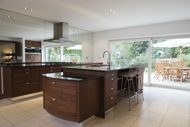 Speaking Of Storage, This Kitchen Island Has It In Abundance. The Sleek  Curved Wood Design Of The Extension Allows For A Pair Of Massive Drawers,  ...