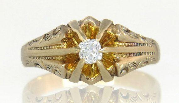 ~ Featured for sale here is an estate Victorian antique genuine diamond 14K solid gold mens ring.  ~ One .15ct genuine natural diamond is set in this traditional Victorian Mens ring. ~ Six prongs securely hold in this this sparkling genuine diamond; hnad carved and engraved detail throughout this piece!  ~ This is a handsome piece of history that will never go out of style!  ~ Made from solid hallmarked 14K gold with a high polish shine; some original patina on this piece. The original…