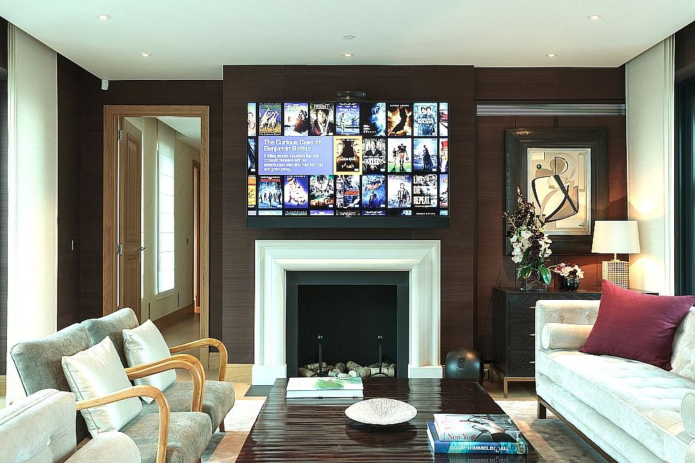 The uhd samsung 75 inch led display mounted above the for Samsung smart tv living room