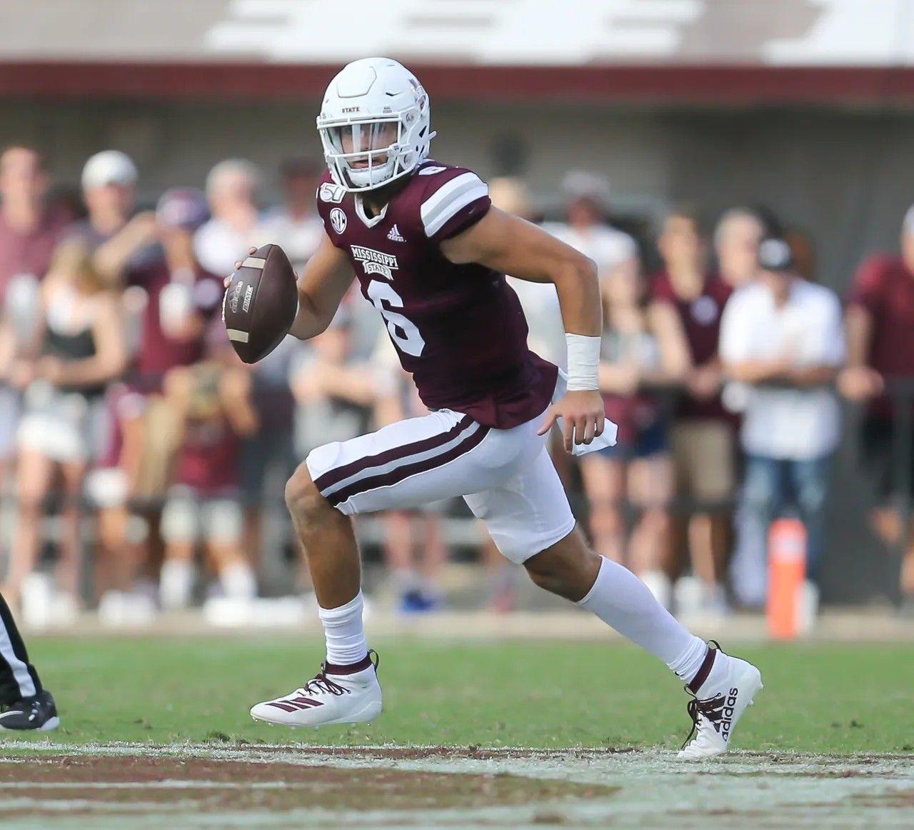 Mississippi State's Garrett Shrader (6) rolls out in the