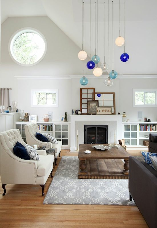 Love the calm feeling of this space and those pendant lights are fun ...