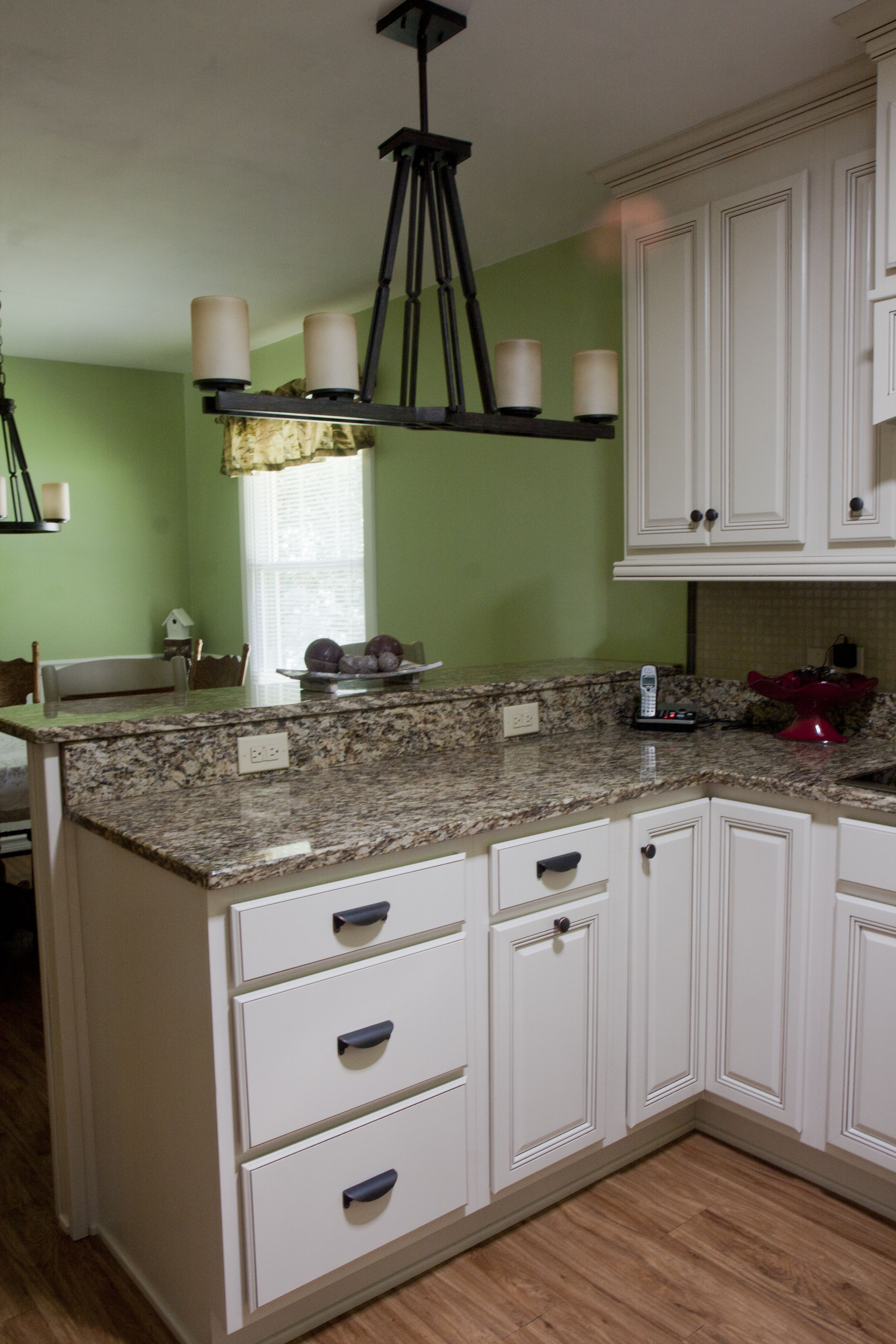 Wellborn Forest Cabinetry   Champagne Paint W/Sable Glaze. Raised Bar Top  Area.