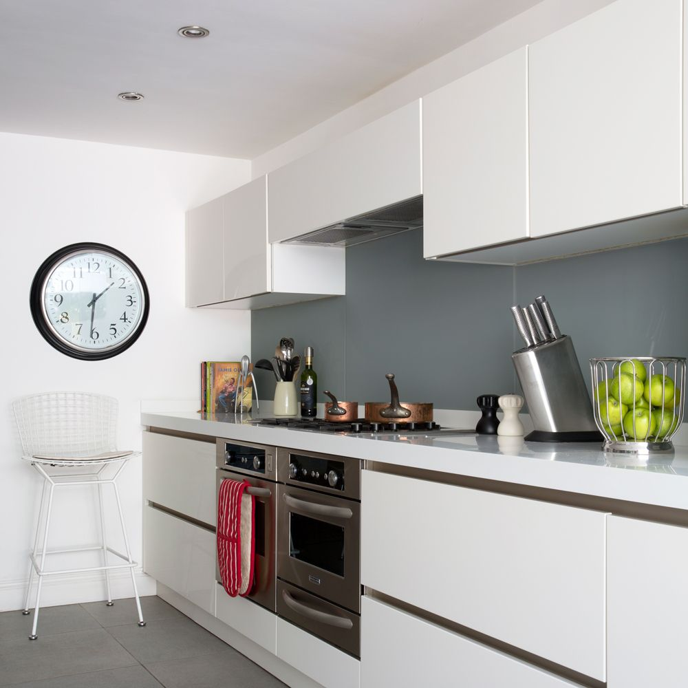 Modern white kitchen with glass splashbacks in smart grey | Home ...