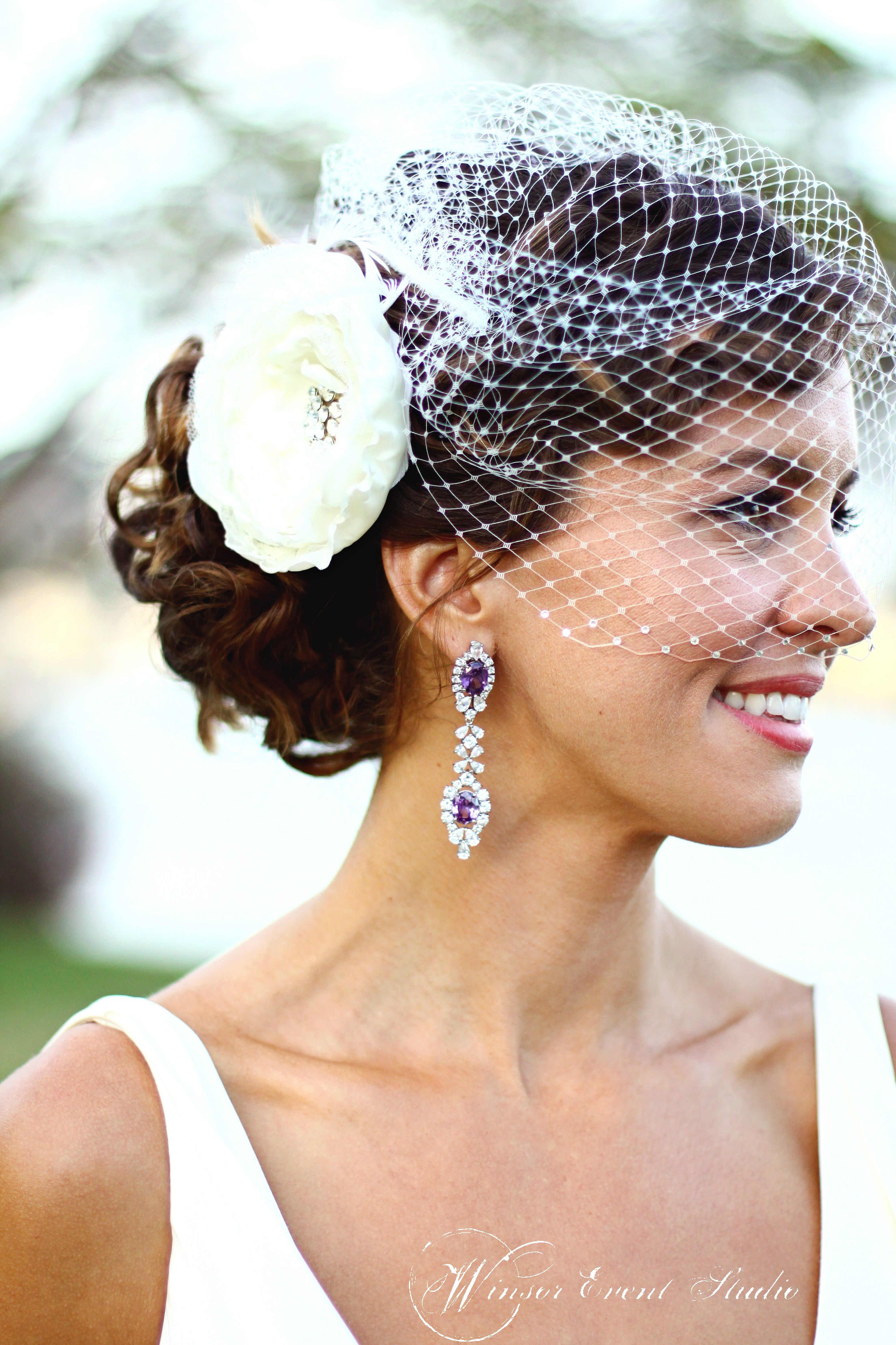 bridal birdcage veil, fabric flower hair clip, and gorgeous purple