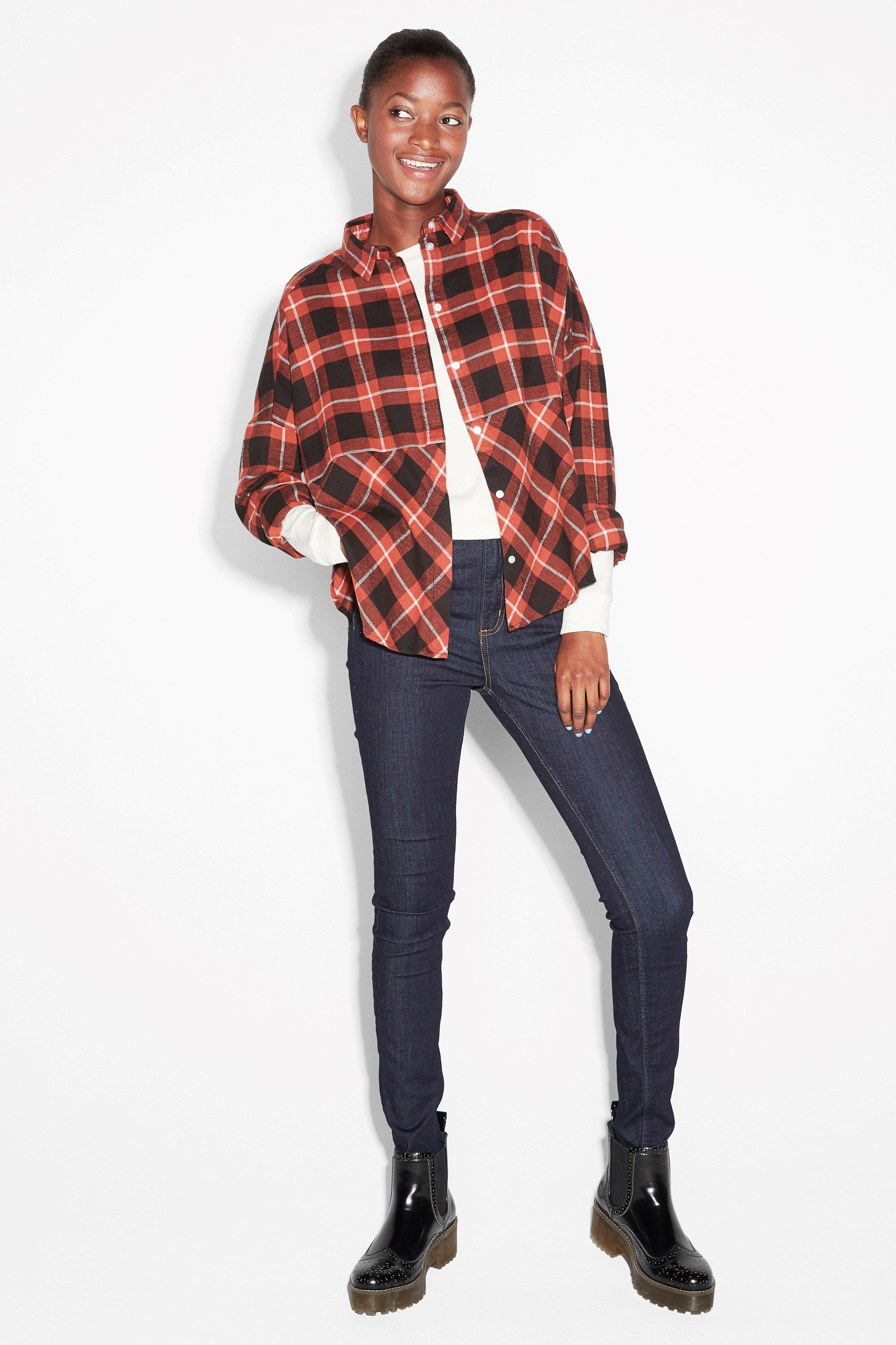 A cosy-cool flannel shirt cut in a hexagonal shape, with the check pattern running diagonally on the bottom half.