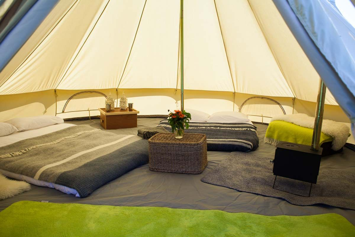 camping experiences with bell tents with stoves