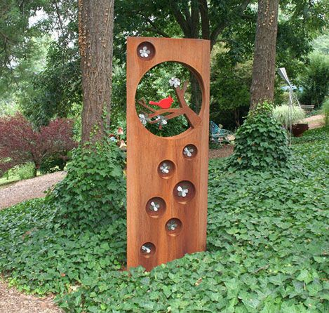 cherry blossoms offered by dale rogers shown at grovewood gallery asheville nc crafts yard sculpturessculptures for salewooden