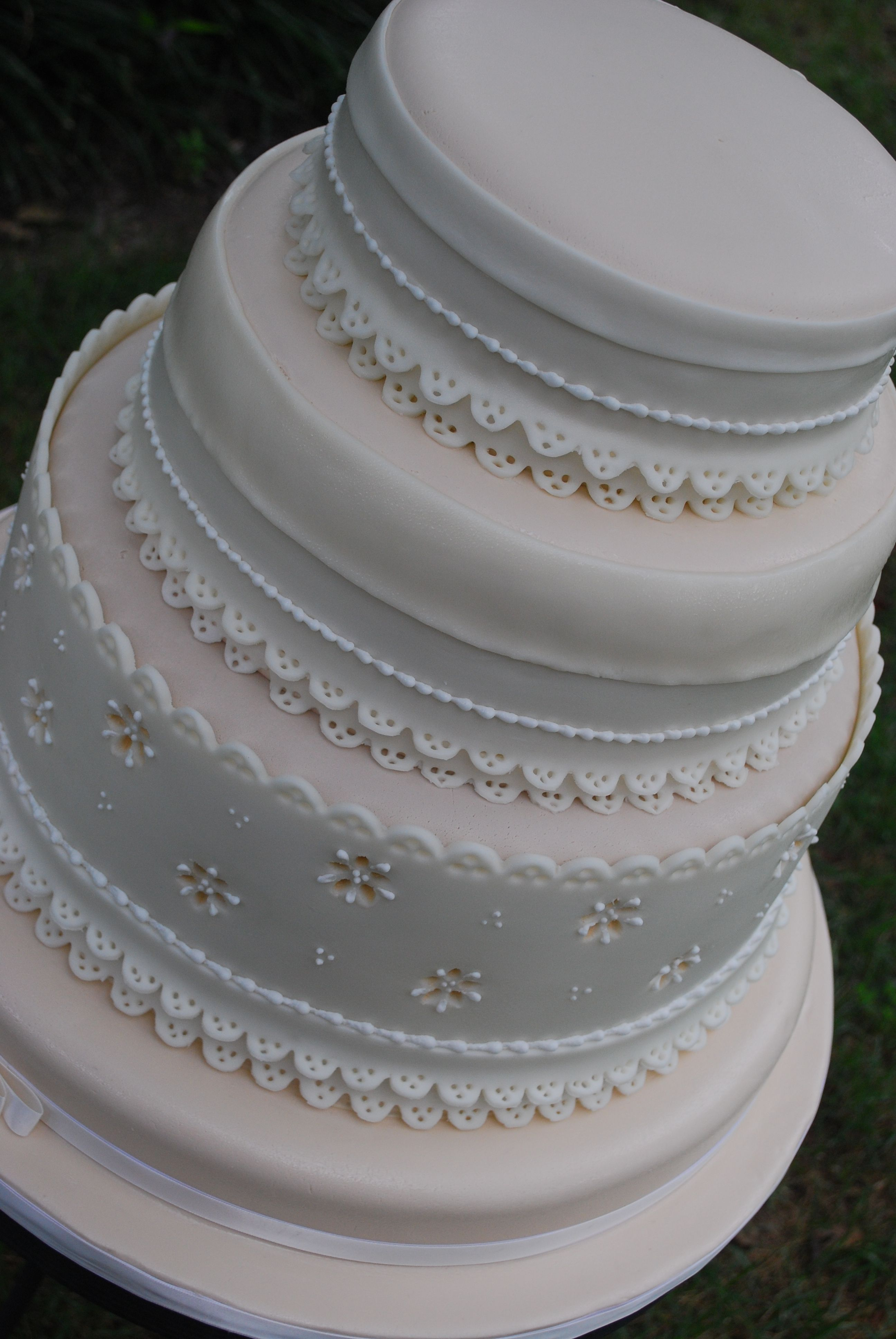 Eyelet Lace wedding cake This cake was covered in an ivory