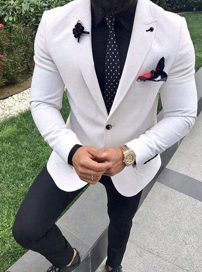 Men's white sport coat/ blazer over black pants with a tie