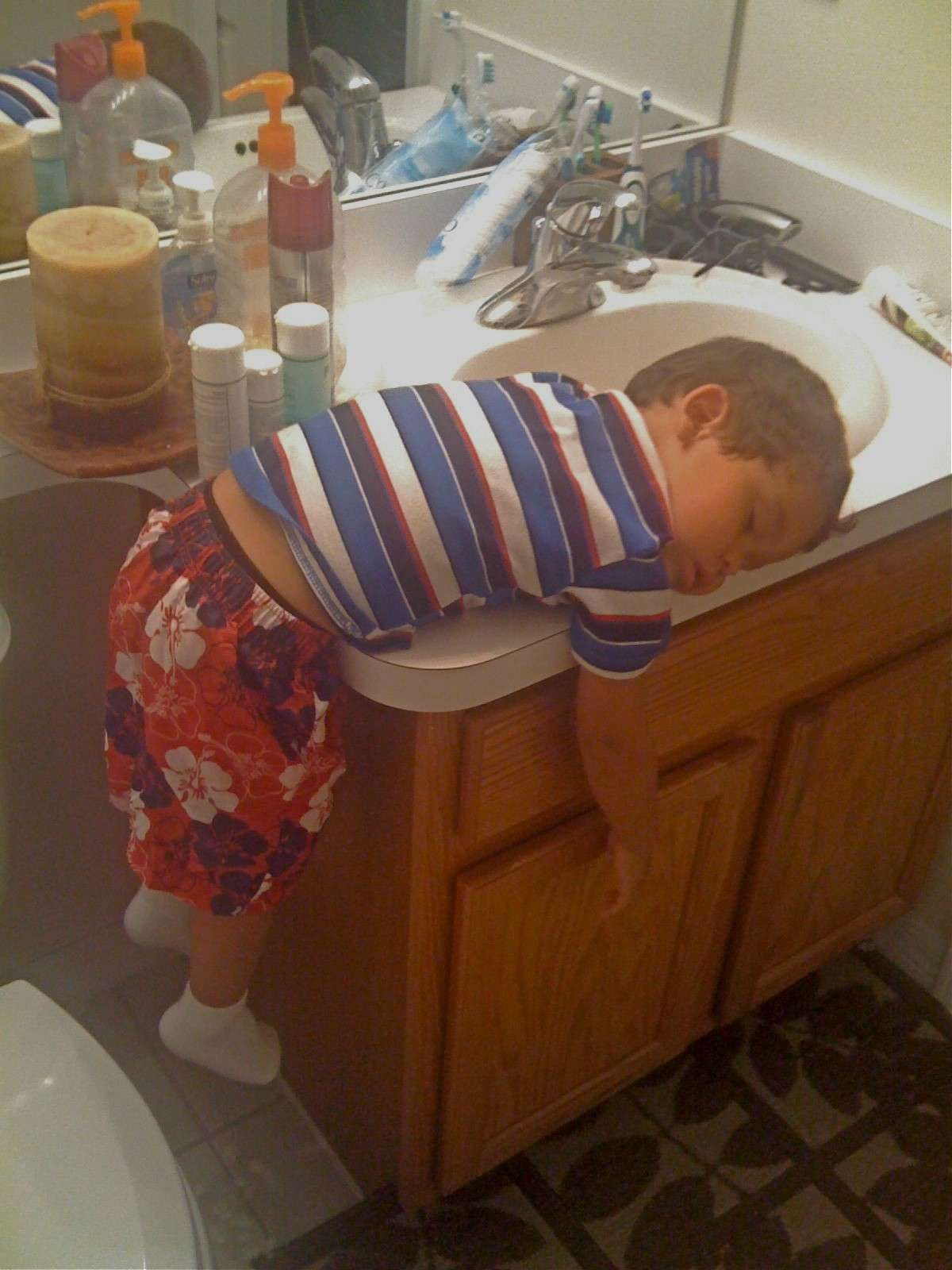 Came In To See Him Totally Asleep. One Arm In The Sink. Water On. Lights Off.