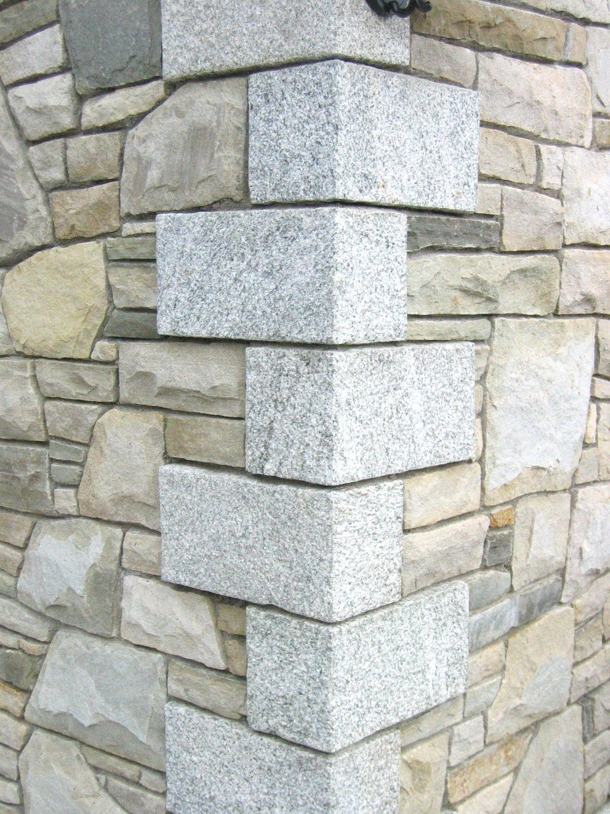 Granite stone quoins add a feature to the corner of your for Brick quoins