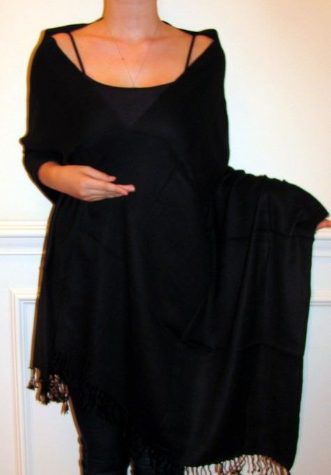 Buy a black wrap for all your outfits as black matches almost any outfit and adds class to your wardrobe.