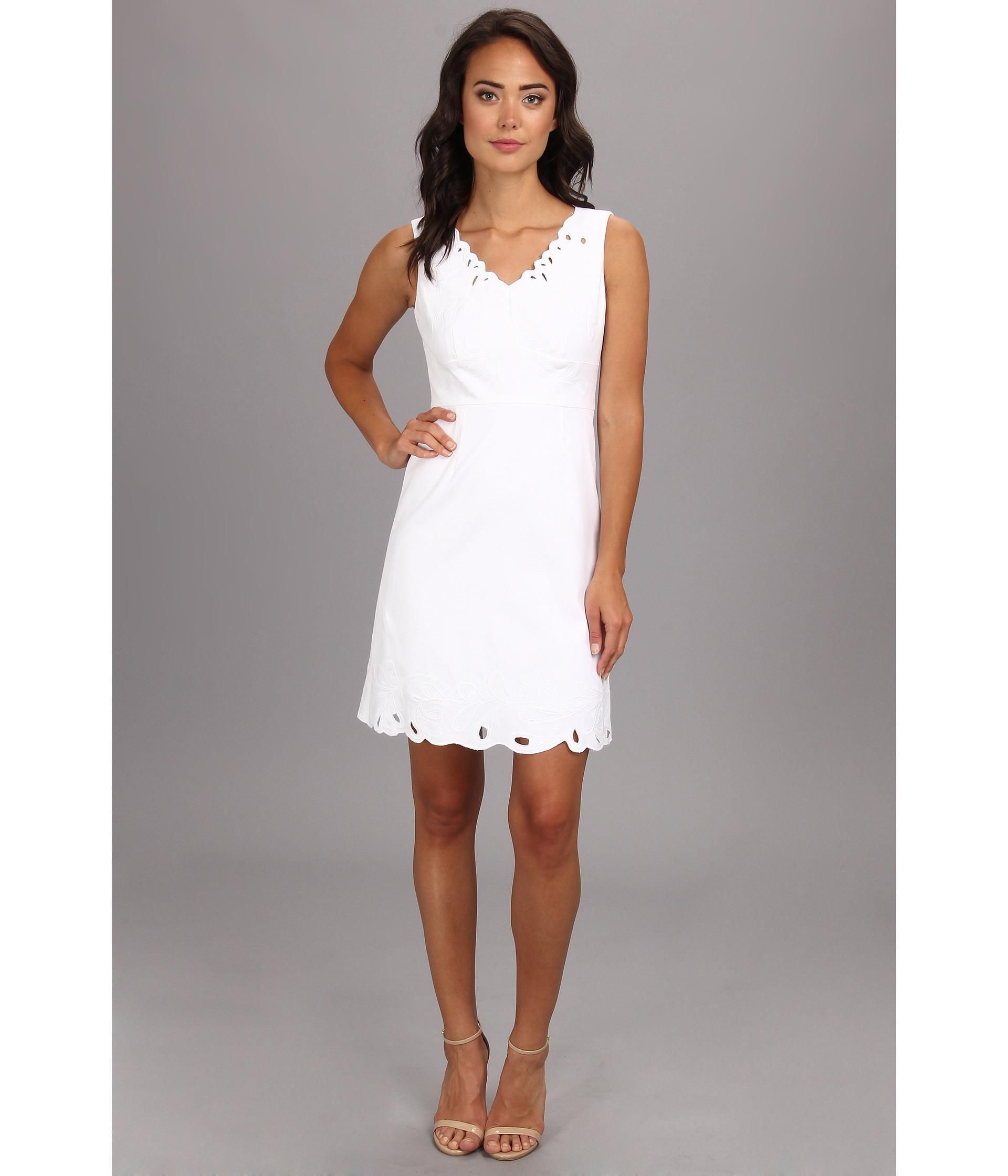 Behold the blooming beauty of this Tahari by ASL™ sheath dress.. Sleeveless dress boasts cutout de...