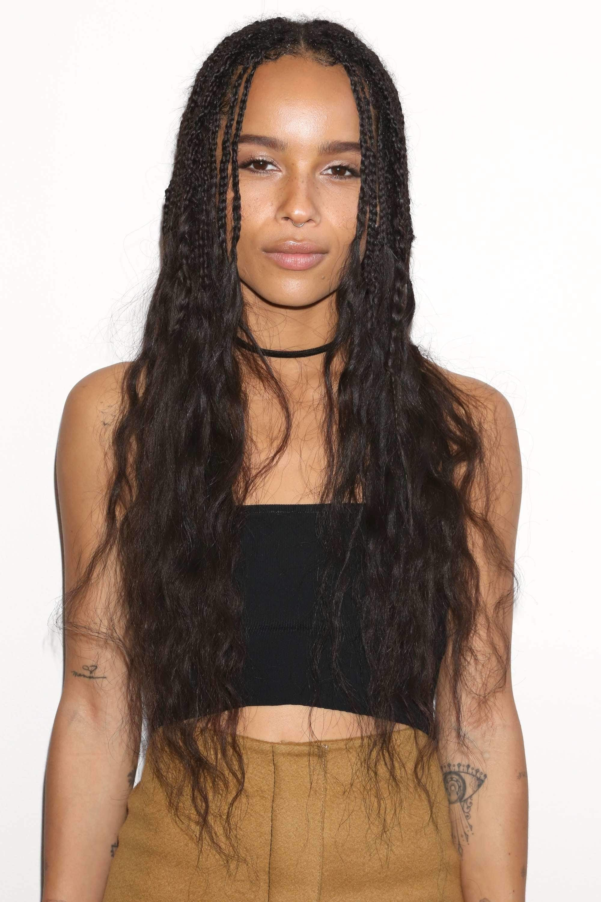 close up shot of zoe kravitz with curly box braids ends