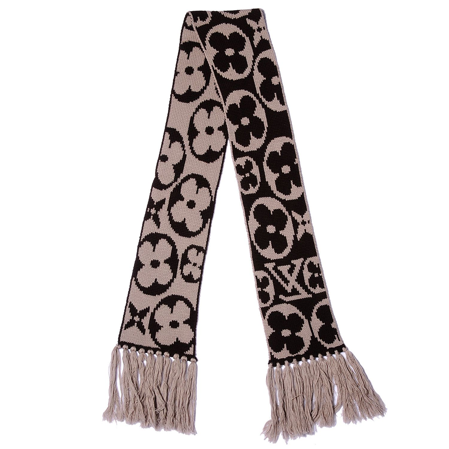Fashionphile louis vuitton monogram knit wool fringe scarf ebene this stylish scarf is made of soft and warm 100 wool knit and feature traditional symbols from the louis vuitton biocorpaavc Images