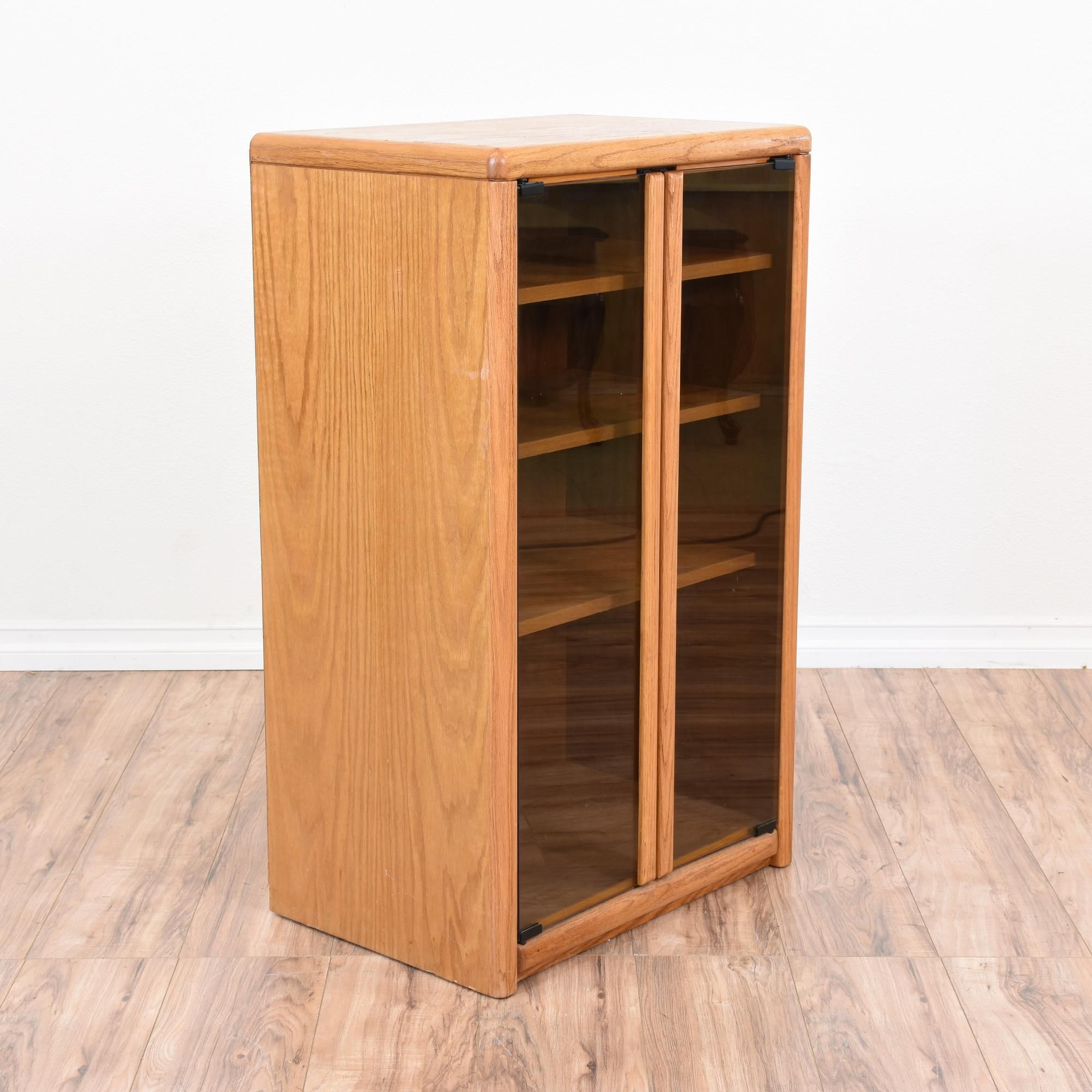 This Media Cabinet Is Featured In A Solid Wood With A Light Honey