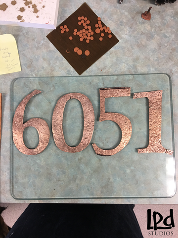 LPDstudios Blog: Custom Corner - Copper Metal Address Plaque. Once the numbers were distressed and the edges were smoothed, I fired them in my special kiln designed for metal clay. The high heat of the kiln burned off the binder in the metal clay and the particles fused together to create solid copper metal pieces. The color drastically changed from a matte terracotta to a high luster copper.