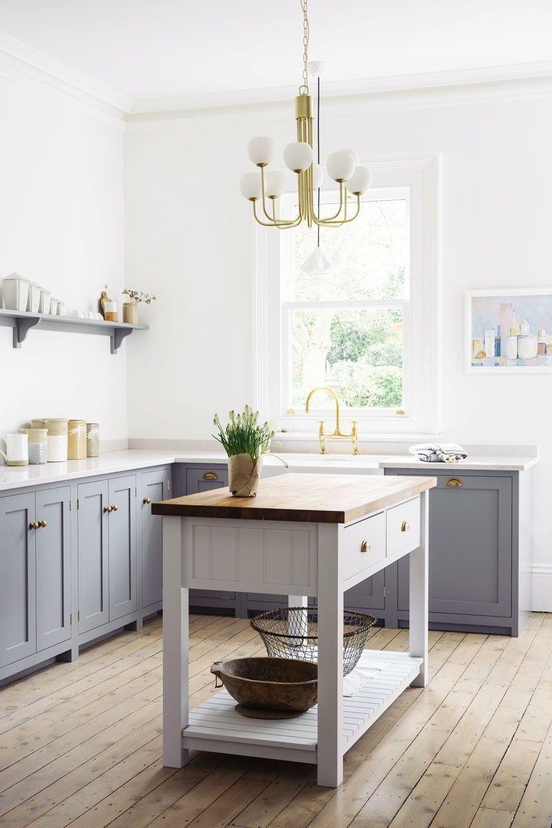 Contemporary kitchen design with freestanding kitchen island cart and modern brass chandelier on thou swell thouswellblog