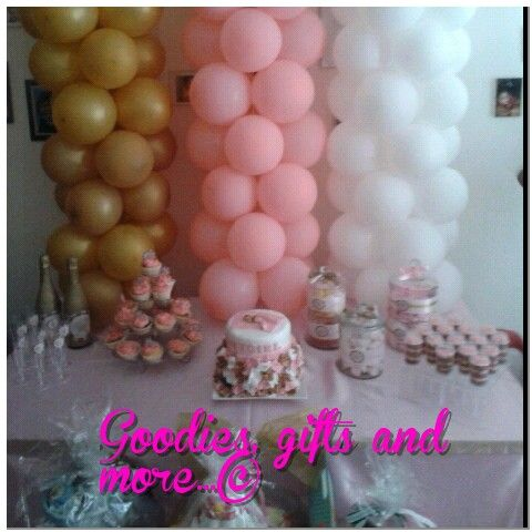 Decorations At A Gold,pink And White Babyshower.