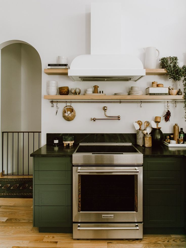 This Green Kitchen Taught Us Six Save Vs. Splurge Remodel Lessons #darkkitchencabinets