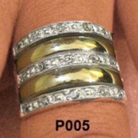 BAIXOU OS PREÇOS DOS ANÉIS DE PRATAS!!! <br>Anel em prata 950 com 3 fileiras de zirconias e duas com apliques de ouro. Medida da parte de cima: 18x14 mm. Peso medio 4,5 g