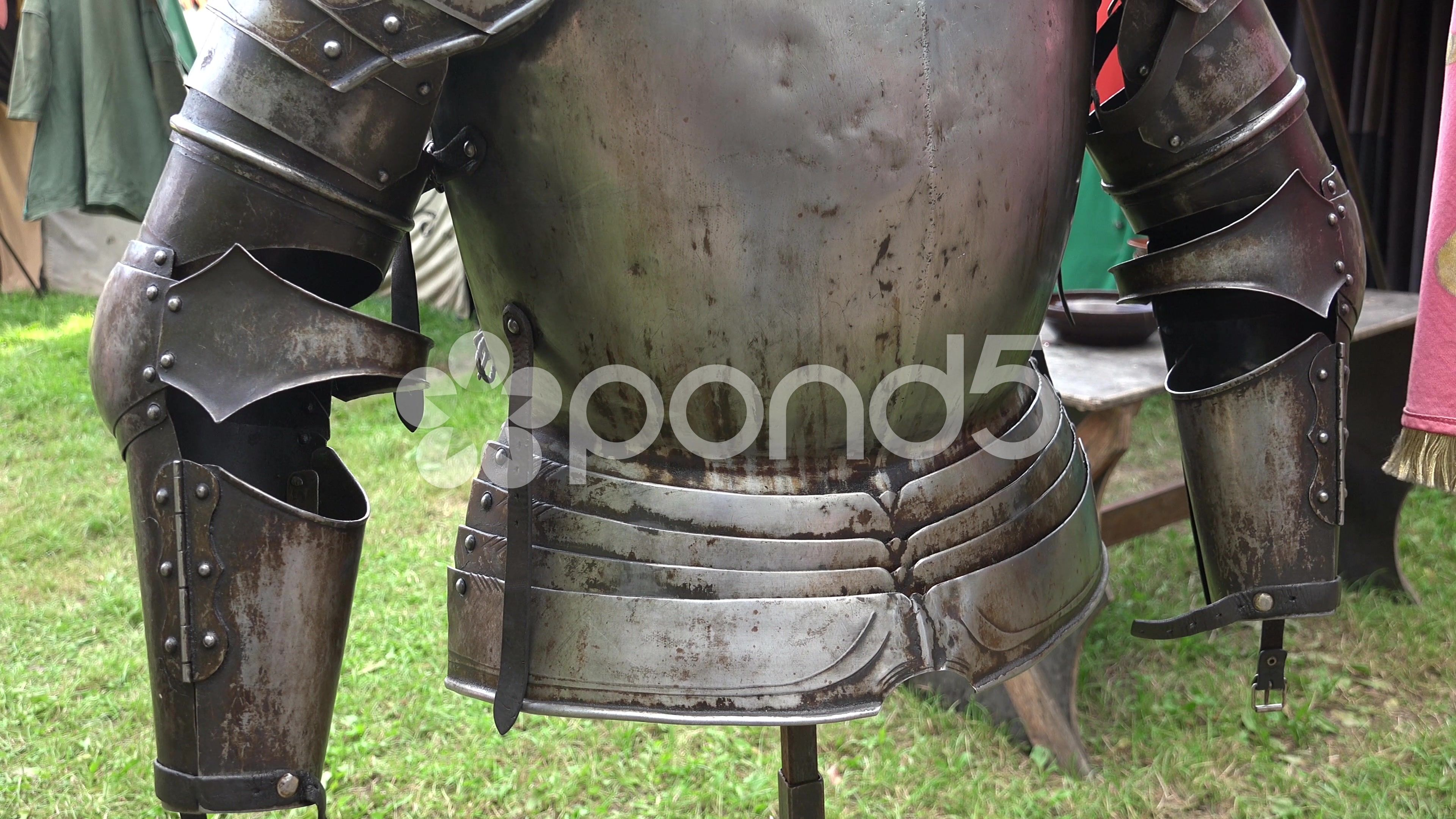 4k Knight's armor close up tilt at medieval pageant event - Stock Footage | by Beckhusen
