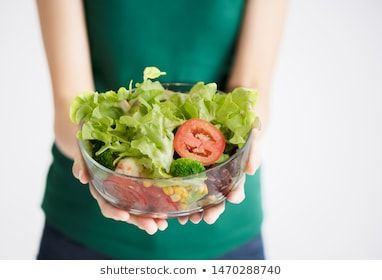 woman holding vegetable salad bowl close up over white background with out of focus blur style on body #at home, #background, #blur, #body, #bodybuilder, #bowl, #breakfast, #closeup, #concept, #corn, #delicious, #diet, #dinner, #eat, #experience, #focus, #food, #fresh, #glass, #good food, #green, #hand, #health, #healthy, #healthy food, #hold, #home made, #idea, #indoor, #lifestyle, #light, #lunch, #meal, #modern, #nutrition, #organic, #out focus, #person, #plate, #salad, #soft, #style, #tomato,